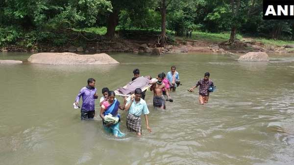 ANI image of locals of Nehala village carrying a pregnant woman on a cot for at least 12 km