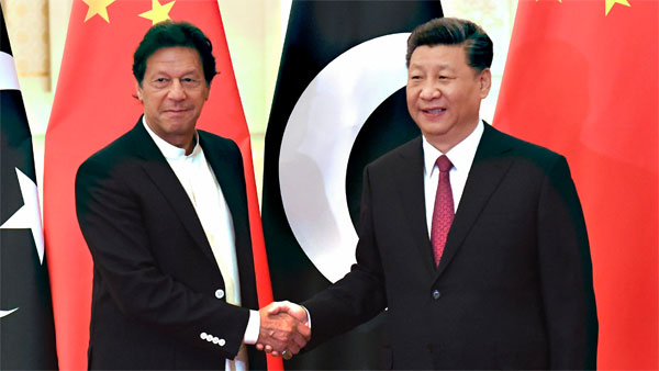 Chinas President Xi Jinping, right, shakes hands with Pakistans Prime Minister Imran Khan