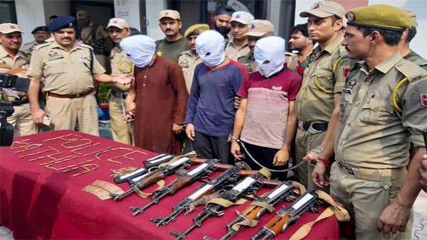 Police personnel show three suspected Jaish-e-Mohammad terrorists, who were arrested after recovery of a huge load of arms and ammunition from a Kashmir-bound truck, in Kathua, Jammu