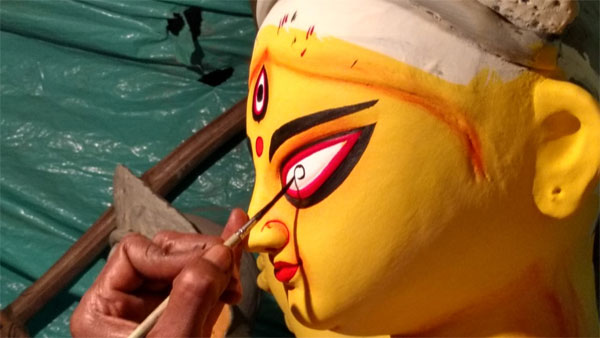 Durga idol making process of eye painting