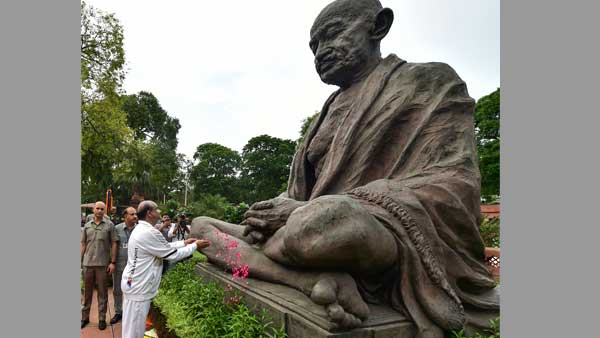 LS Speaker Om Birla paying floral tributes to statue of Mahatma Gandhi