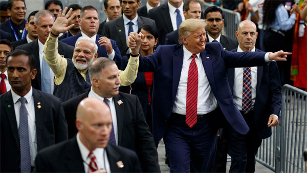President Donald Trump and Indian Prime Minister Narendra Modi walk around NRG Stadium waving to the crowd during the Howdy Modi: Shared Dreams, Bright Futures event