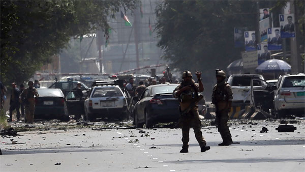 Afghan security personnel arrive at the site of car bomb explosion in Kabul, Afghanistan