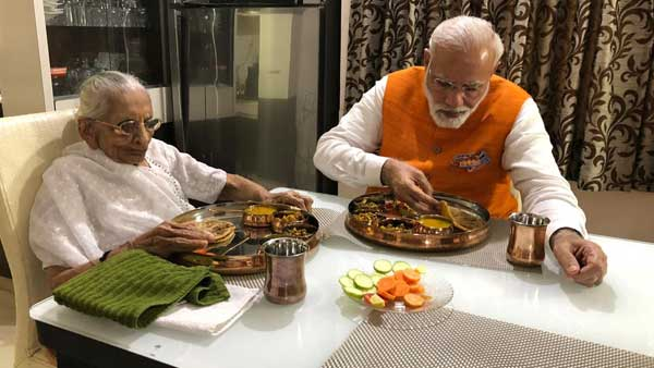 In the image, PM Modi is seen having birthday lunch with his mother