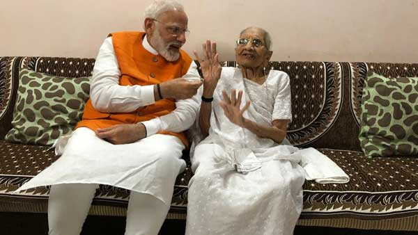 PM Modi interacting with his mother Heeraben Modi