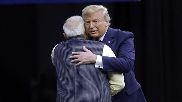 Prime Minister Narendra Modi and President Donald Trump embrace after introductions during the Howdi Modi event