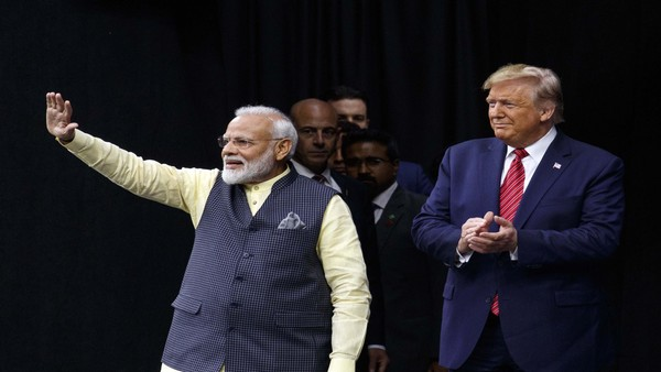 President Donald Trump stands on stage with Prime Minister Narendra Modi at NRG Stadium (PTI photo)