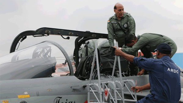Dressed in G-suit, Rajnath Singh flies in home-grown fighter jet Tejas aircraft