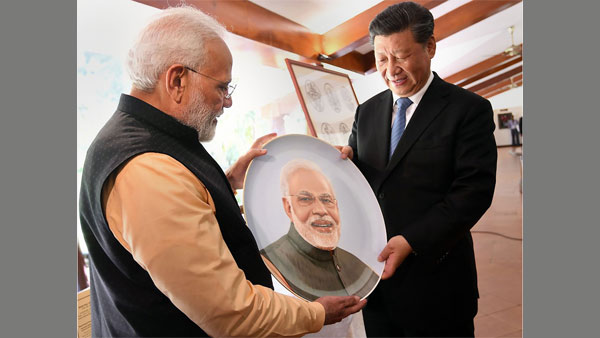 PM Modi and Chinese President Xi Jinping exchange gifts