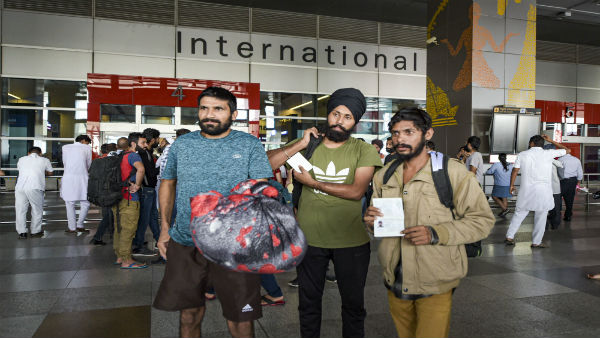 Over 300 Indians deported from Mexico land in Delhi