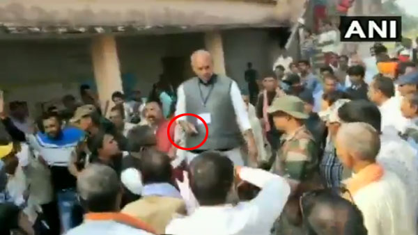 On camera, Congress candidate brandishes pistol outside polling booth in Jharkhand