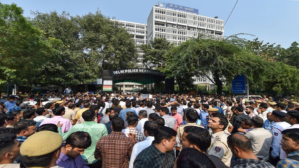 Delhi police personnel gather at the Delhi Police Headquarters at ITO to protest over the alleged repeated incidents of violence against them by lawyers