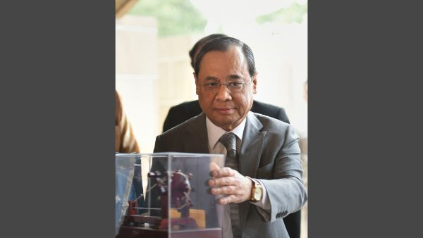 Justice Ranjan Gogoi being presented a memento during his visit to Rajghat