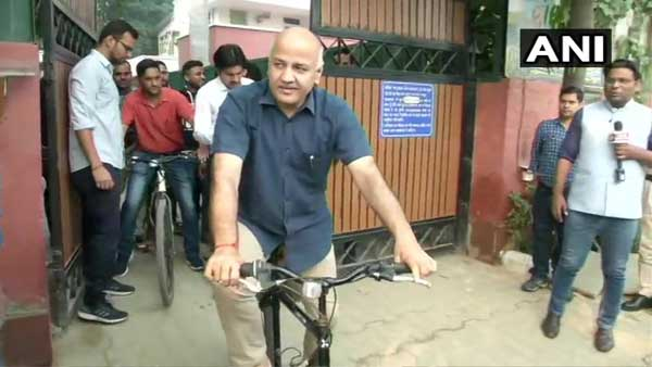 Manish Sisodia seen cycling to work