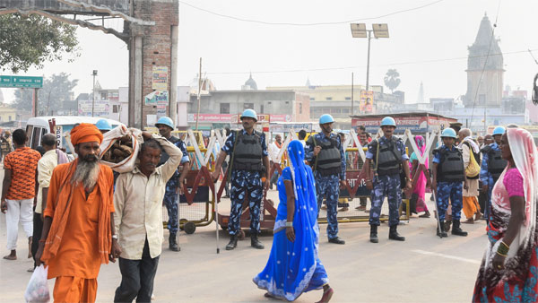 Police personnel stand guard at Naya Ghat in Ayodhya