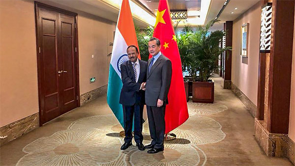 National Security Advisor, Ajit Doval shakes hands with Chinese Foreign Minister, Wang Yi