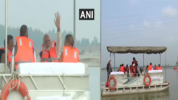 PM Modi rides boat in Ganga at Atal ghat, reviews Namami Gange project