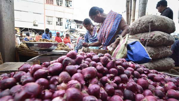 Women purchase onions at a wholesale market