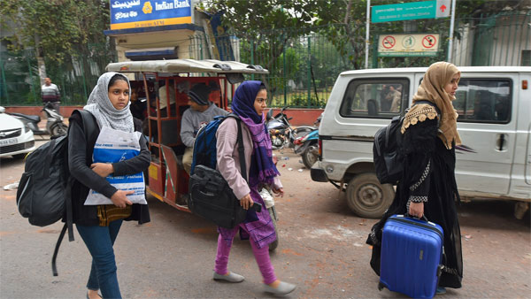 Students leave from Jamia Millia Islamia as the university is closed till Jan. 5 following the protests aginst Citizenship Amendment Act, in New Delhi