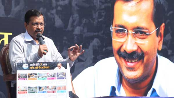 Delhi polls: Kejriwal releases AAPs guarantee card, promises quality education, free bus