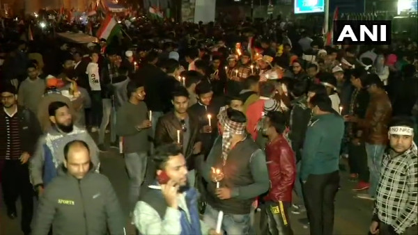 Hundreds take out anti-CAA candle light march from Jamia Millia gate to Shaheen Bagh