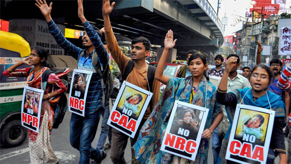 TMC women members in Kolkata sport mehendi with no CAA , NRC slogan