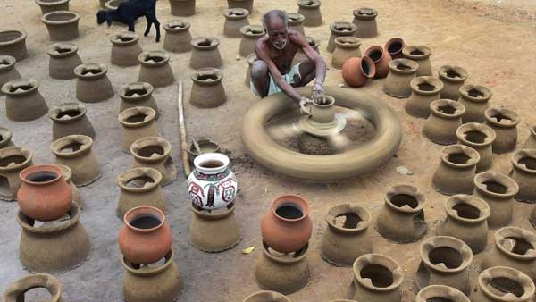 Potter engaged in making pots ahead of the Harvest festival 'Pongal' :