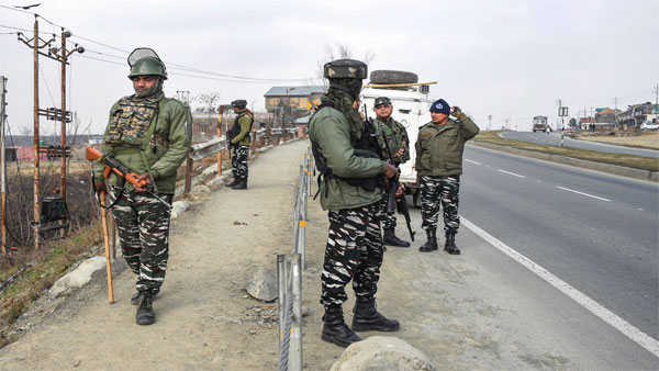 CRPF personnel stand guard at the spot where deadly 2019 Pulwama terror attack took place, at Lethipora of Pulwama District, South Kashmir