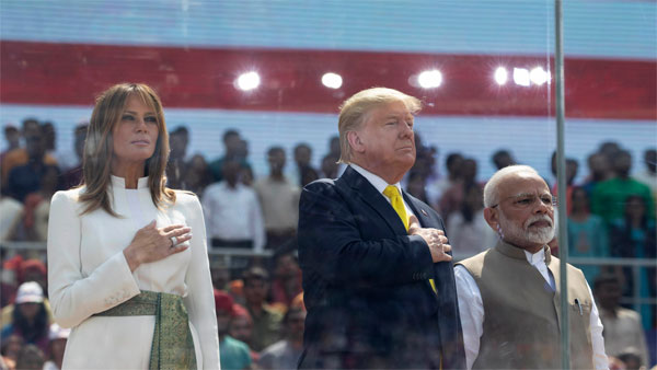 U.S. President Donald Trump, first lady Melania Trump and Indian Prime Minister Narendra Modi stand during the national anthem during a Namaste Trump, event at Sardar Patel Gujarat Stadium