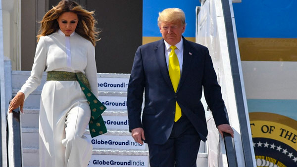 Donning white jumpsuit and green sash outfit, Melania pays tribute to Indian textiles