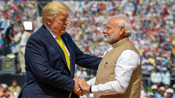 Prime Minister Narendra Modi shakes hands with US President Donald Trump