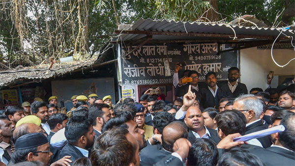 Sanjeev Lodhi (R with raised finger), joint secretary of the Lucknow bar association, along with other lawyers stage a protest after a crude-bomb exploded in the premises of a court, in Lucknow