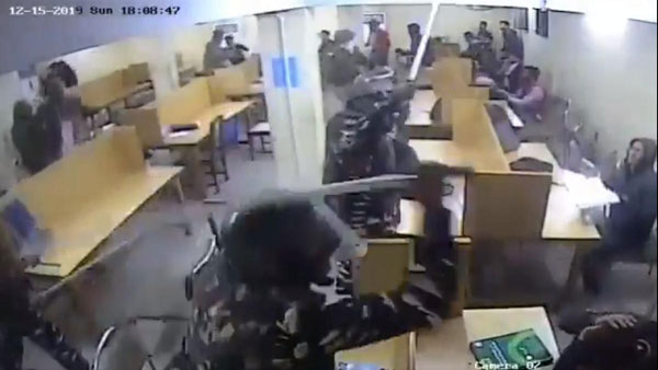 Jamia Millia Islamia video shows Delhi police using force in library, triggers political storm