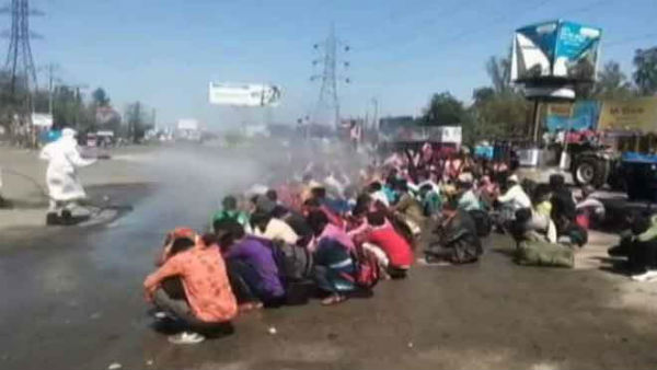 Furore after migrants sanitised with chemical spray in Bareilly