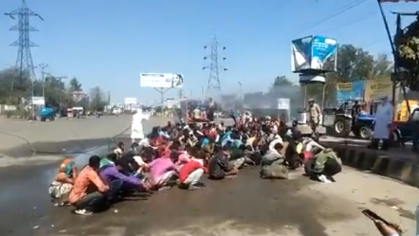 Migrants in UP get a 'chemical bath:' Inquiry ordered