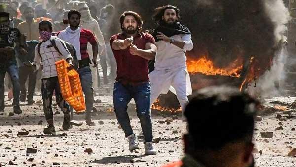 Delhi violence: Shahrukh, man who pointed gun at policeman arrested