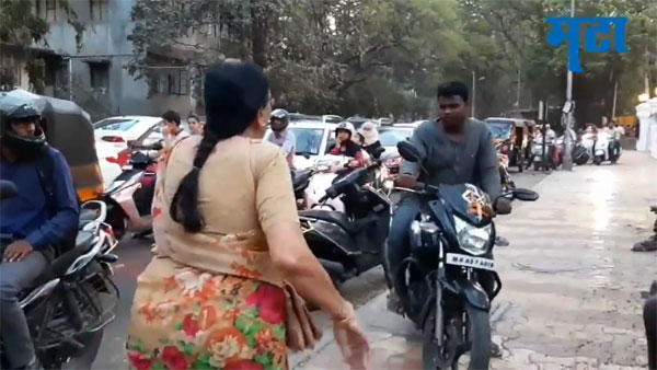 Anand Mahindra priases Pune teacher for getting bikers off footpaths