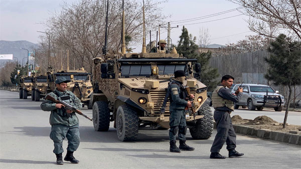 Foreign security personnel and Afghan police arrive at the site of an attack in Kabul, Afghanistan