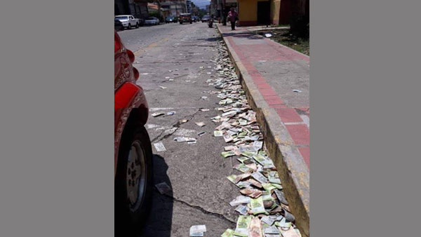 Fake: People in Italy are not throwing their money on the streets due to COVID-19