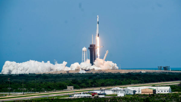 Elon Musk's SpaceX rocket ship blasts off into orbit with 2 Americans