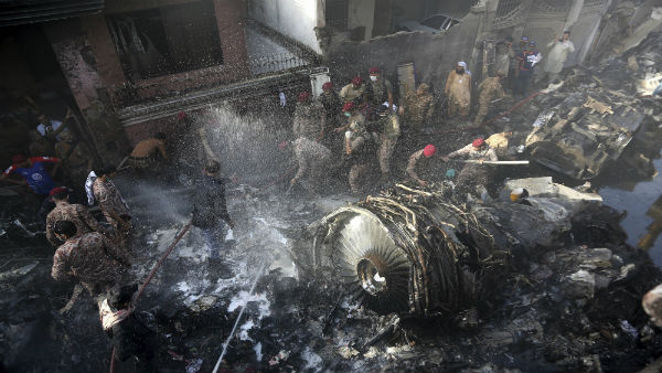 Pakistan plane with 99 on board crashes in Karachi, at least 3 survivors