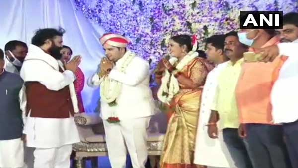 Karnataka Health Minister again flouts rules: This time seen without mask at wedding