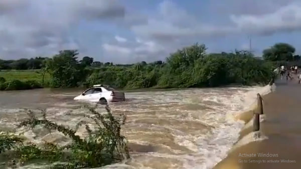 Watch: Passengers escape in the nick of time as car gets washed away