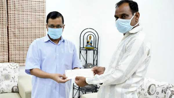 Arvind Kejriwal gives Rs 1 crore cheque to family of Corona warrior Dr Joginder Chaudhary