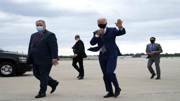 Trump mocks the way Biden wears his mask