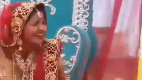 Fact check: The real story behind the laughing bride onstage