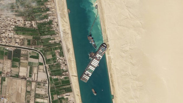 Container ship stuck in Suez Canal re-floated partially