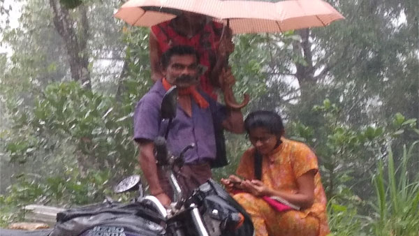 Image of father holding up umbrella as daughter attends online class goes viral