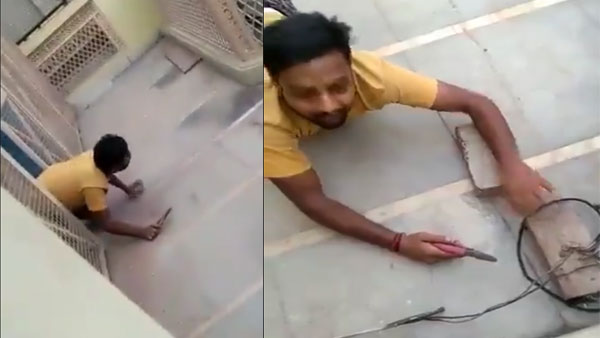 Man crawling like a snake to cut his illegal power connection is rib tickling: Watch