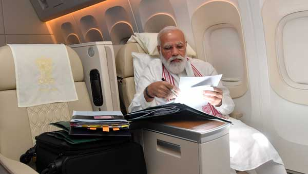 On a long flight to the US, PM Modi spends time clearing files, doing paper-work